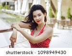 woman dressed in a red blouse... | Shutterstock . vector #1098949430