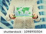 young woman holding tablet... | Shutterstock . vector #1098950504