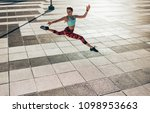 fitness woman doing split jump... | Shutterstock . vector #1098953663