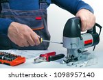 professional technician working ... | Shutterstock . vector #1098957140