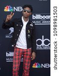 Small photo of 21 Savage attends the Red Carpet at the 2018 Billboards Music Awards at the MGM Grand Arena in Las Vegas, Nevada USA on May 20th 2018