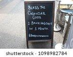 'bless the calendar gods' sign... | Shutterstock . vector #1098982784