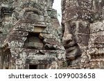 mossy stone face of ancient... | Shutterstock . vector #1099003658