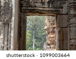 stone carved face of ancient... | Shutterstock . vector #1099003664