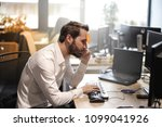 young businessman in the office  | Shutterstock . vector #1099041926
