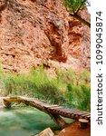 wooden foot bridge crossing ... | Shutterstock . vector #1099045874