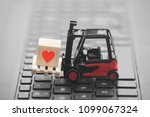 forklift with red heart symbol... | Shutterstock . vector #1099067324
