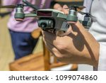 Man hand holding a mini drone with camera ready to be released in the sky - stock photo
