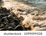 waves hit to the stones on the... | Shutterstock . vector #1099099328