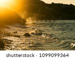 stony beach with waves and with ... | Shutterstock . vector #1099099364