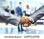 handshake in front of business... | Shutterstock . vector #109910390