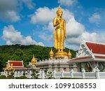 golden standing buddha at the... | Shutterstock . vector #1099108553