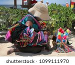woman sales souvenirs on a... | Shutterstock . vector #1099111970
