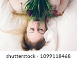 girl with flowers lying on a... | Shutterstock . vector #1099118468