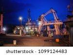 ships at the marina at night... | Shutterstock . vector #1099124483