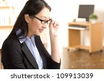 attractive asian woman at work... | Shutterstock . vector #109913039