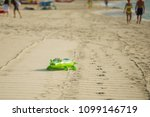 inflatable crocodile on a sandy ... | Shutterstock . vector #1099146719