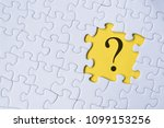 question mark on jigsaw puzzle... | Shutterstock . vector #1099153256
