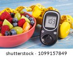 fresh salad  glucose meter with ... | Shutterstock . vector #1099157849