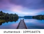 lake mapourika at sunset  ...   Shutterstock . vector #1099166576