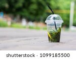 a cup of mojito stands on the... | Shutterstock . vector #1099185500