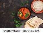 chicken tikka masala with rice. ... | Shutterstock . vector #1099187126