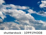 white clouds against the blue...   Shutterstock . vector #1099194308
