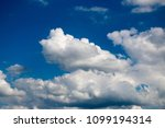 white clouds against the blue...   Shutterstock . vector #1099194314