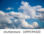 white clouds against the blue...   Shutterstock . vector #1099194320