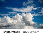 white clouds against the blue...   Shutterstock . vector #1099194374