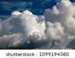 white clouds against the blue...   Shutterstock . vector #1099194380