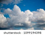 white clouds against the blue...   Shutterstock . vector #1099194398