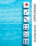 Small photo of Top view of Colorful Rolling the dice concept for business risk, chance, good luck or gambling.wooden blue background.
