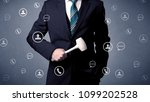 thoughtful businesman holding... | Shutterstock . vector #1099202528
