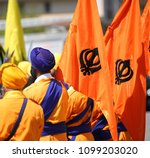 men with orange flags and sikh... | Shutterstock . vector #1099203020