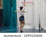 a hula hoop performer  a young... | Shutterstock . vector #1099220600