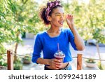 charming  black woman with... | Shutterstock . vector #1099241189