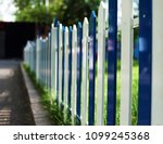 dark light  symbolical fence | Shutterstock . vector #1099245368