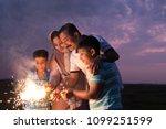the family enjoying the sparkle ... | Shutterstock . vector #1099251599
