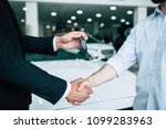 buying a new car. handshake and ... | Shutterstock . vector #1099283963