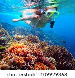 woman with mask snorkeling in... | Shutterstock . vector #109929368