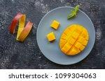 sliced ripe mango fruit with... | Shutterstock . vector #1099304063