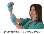 young female doctor prepares to ... | Shutterstock . vector #1099325930