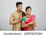 attractive happy north indian...   Shutterstock . vector #1099329104