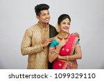 attractive happy north indian... | Shutterstock . vector #1099329110