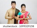 attractive happy north indian...   Shutterstock . vector #1099329158