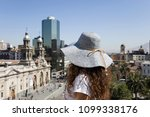 young woman with hat looking at ... | Shutterstock . vector #1099338176