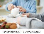 hands of senior man with white... | Shutterstock . vector #1099348280