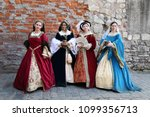 women in medieval clothes... | Shutterstock . vector #1099356713