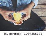 potato chips in the bag on hand | Shutterstock . vector #1099366376